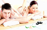 Attractive young couple enjoying a back massage in a spa center