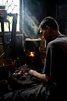 A worker at the workshop of a grinding factory, in Ferighat, Khulna, Bangladesh March 1, 2008
