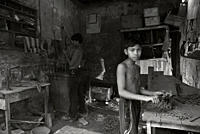 Hassan, a 13 year old kid, works at a chain making factory, in Khulna Railway market to earn 600 taka per month His father is a security guard of the ...