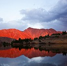 Colorado Rocky Mountains reflecting in Pass Lake at sunset. Pass Lake is located directly on the continental divide