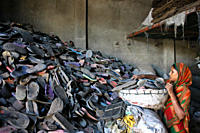 A large number of women in Dhaka city work in the recycle factories where old and rejected sponge sandals are recycled to make plastic products Dhaka,...