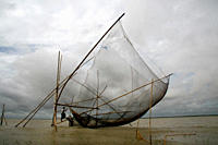 A traditional fishing net on the Jamuna river Aricha ghat in Dhaka, Bangladesh July 10, 2009