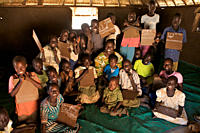 A group of children with their teacher in a BRAC Non Formal Primary School NFPE, in the village of Hai Police, in Torid Many children, who missed scho...