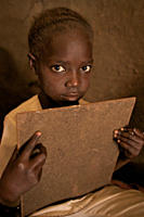 A girl attending a BRAC Non Formal Primary School NFPE, in Hai Police village, in Torid Many children, who missed school due to decades of war and ins...