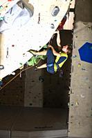 Man climbing on a overhang inside a climbing gym, Linz, Upper Austria, Austria