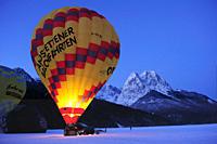 Three hot_air balloons being filled, Waxensteine in background, Garmisch_Partenkirchen, Wetterstein range, Bavarian alps, Upper Bavaria, Bavaria, Germ...