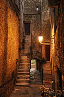 Stairs in narrow alley at medieval town in the evening, Capalbio, Maremma, Province Grosseto, Tuscany, Italy, Europe