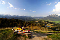 Couple hiking, enjoying the view from Kranzberg, View towards the Karwendel, Mittenwald, Upper Bavaria, Bavaria, Germany, Europe