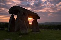 The Sun Setting Through the Stones of Pentre Ifan and reflecting in the distant waters of Cardiganshire Bay  One of the finest Megalithic monuments in...