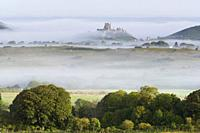 Corfe Castle in the mist taken from the village of kingstone high up on the hills over looking Corfe