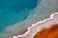 Colourful mineral deposits at Black Pool hot spring in Yellowstone National Park in Wyoming, United States