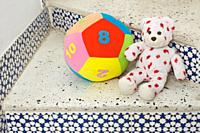 Child's teddy bear and soft ball toys