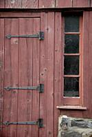 The hinges still hold on an old barn door