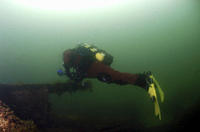 Diver on British Blockship Ilsenstein, Scapa Flow, Orkney islands, Scotland, UK