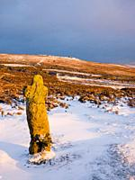 Bennetts Cross in winter snow in Dartmoor National Park near Postbridge, Devon, England, United Kingdom