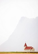 Isolated church with hazy outline of distant mountain in the background, Snaefellsnes Peninsula, Iceland, Polar Regions