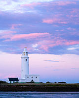 England, Hampshire, Milford on Sea. Hurst Point Lighthouse at the end of Hurst Spit, a shingle bank that extends 2.5km from the end of Milford beach o...