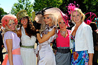 England, Berkshire, Ascot. A group of smartly dressed women wearing elaborate hats attending day three of Royal Ascot 2010.