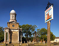 England, Essex, Mistley. Mistley village sign and one of the twin towers that once formed part of the old Church of St. Mary the Virgin. The towers we...