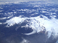 Aerial views of snow_capped mountains, ice fields, and glaciers on a charter flight from Santiago, Chile to Ushuaia, Argentina along the spine of the ...