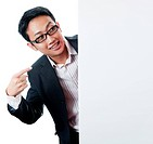 Smiling Asian Executive male pointing on a blank space