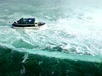 People on Made of the Mist boat ride approaching Niagara Falls Horseshoe edge