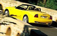 Car, Maserati Spyder, model year 2001_, yellow, driving, diagonal from the back, Convertible, 390 PS, 4,2 literss V8 engine, ams 21/2001, Seite 004