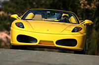 Car, Ferrari F430 Spider, model year 2005_, yellow, Convertible, driving, diagonal from the front, frontal view, open top, country road