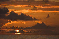 Sunrise or sunset at sea in the Atlantic Ocean from onboard the National Geographic Endeavour crossing the Atlantic Ocean from Lisbon, Portugal to Sal...