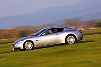 Maserati Gran Turismo, silver, model year 2007_, driving, side view, country road