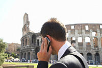 Italian businessman talking on cell phone outdoors