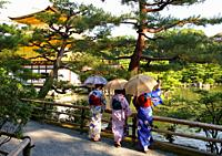 Japanese women with Kimono, Kinkakuji Temple, The Golden Pavilion, Rokuon-ji temple, Kyoto, Japan.