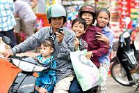 Family on motor bike, Phnom Penh, Cambodia