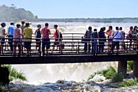 Tourists at the Devil's throat waterfall platform, Iguazu National Park, Argentina