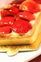 strawberry tart on a serving tray