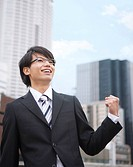 Young businessman making a fist