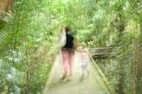 A mother and child walking on a boardwalks at Fog Dam in the Northern Territory of Australia
