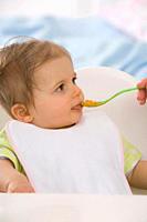Human hand feeding baby girl 6_11 months
