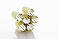 Stack of bur curlers against white background