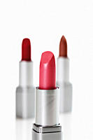 Close up of lipsticks against white background