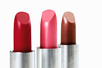 Row of lipsticks against white background