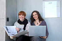 Germany, Leipzig, University students using laptop, smiling, portrait