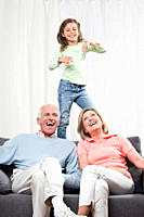 Granddaughter 6_7 dancing and grandparents enjoying, smiling
