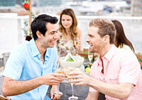 Smiling friends drinking Champagne at outdoor party