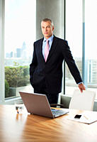 Businessman standing at desk in office