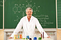Germany, Emmering, Senior man standing in chemistry lab, smiling, portrait (thumbnail)