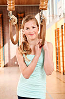 Germany, Emmering, Girl 12-13 holding flying rings and smiling, portrait (thumbnail)