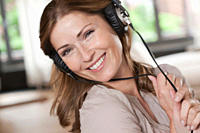 Germany, Close up of woman listening music, portrait