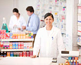 Pharmacist standing at cash register in drug store