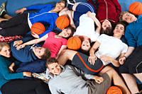 Germany, Berlin, People lying in gym, portrait